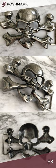 "SKULL & CROSS-BONE BIKER BELT BUCKLE Antique Silver Design Add a cool accessory to your belt collection with the Skull Crossbones Belt Buckle. Made of zinc alloy this durable buckle is designed to fit your standard 1.5"" snap on belt. FSolid silver a toned buckle. Fits a Standard 1.5"" Snap On Belt Crafted in Zinc Alloy Accessories Belts"