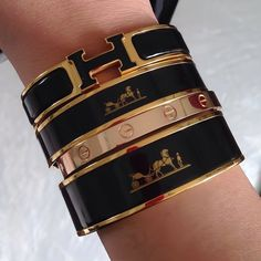 Hermes black and gold cuff / bracelets