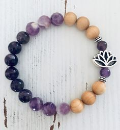 Excited to share this item from my shop: Wood & Amethyst Healing Genstome Stretch Diffuser Bracelet with Lotus charm Healing Crystal Jewelry, Healing Bracelets, Crystal Bracelets, Beaded Jewelry, Handmade Jewelry, Skull Jewelry, Tribal Jewelry, Modern Hippie, Hippie Chic