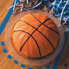 Basketball Cake ~ Dimpled orange frosting and licorice laces make this basketball cake look deliciously realistic. It's as much fun to make as it is to eat.