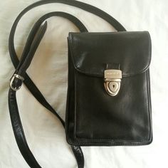 Perlina Crossbody Bag  NWOT This buttery soft black leather bag is perfect for travel when you just don't feel like lugging around a big tote ! This has 2 front interior pockets. Back zipper pocket with 7 card slots and clear ID slot, pen holder.  Snap back pocket to hold your Cell.  Adjustable 55 in. Strap. A few very tiny scratches on the latch from being stored on a closet shelf, but are hardly noticeable ! Other than that, its in Perfect Condition. Perlina Bags Crossbody Bags