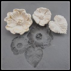 Hand carved large and small flower and leaf.