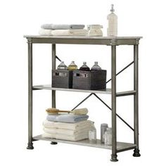"""Two-shelf metal etagere with a marble-finished top and x-crossed back. Product: ÉtagèreConstruction Material: Powder coated metalColor: MarbleDimensions: 39"""" H x 38"""" W x 16"""" D"""