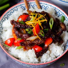 Crispy Orange Beef Recipe Main Dishes with vegetable oil, beef steak, corn flour, salt, orange, orange, caster sugar, soy sauce, garlic, ginger, rice vinegar, red pepper, onions, rice, spring onions