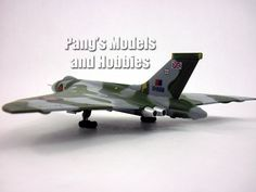 """1:144 Scale Diecast Metal - Avro Vulcan Length: 8.25"""" Wingspan: 9"""" This Vulcan model has its landing gear modeled in the extended position and is fixed. A display stand with information about the part"""