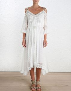 Realm Scallop Dress, from our Summer Swim 16 collection, in White silk crinkle georgette with dot embroidery. Scalloped eyelash lace trim hem and neckline. Off the shoulder neckline with shoestring strap ties. Full length blouson sleeve with elastic cuff. Lined.