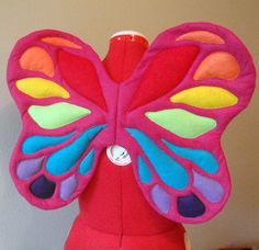 . Felt butterfly or faery wings that won't get thrashed. No wire. Smart.