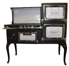 "From the 1920's, this unique Occidental stove is 50"" wide, with 4 burners, and oven and a broiler."