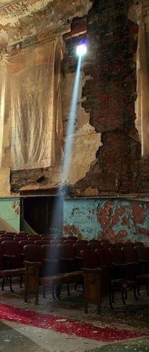 Sunlight streams through a broken window in an old vaudeville theatre Toronto Ontario Canada