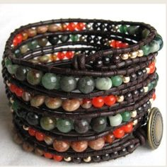 A beautiful leather wrap bracelet crafted by hand.2 mm thick genuine brown leather cord with graduated 3-6mm round and roundel gemstone beads loomed on it.It is finished with an antique brass filigree metal button closure.