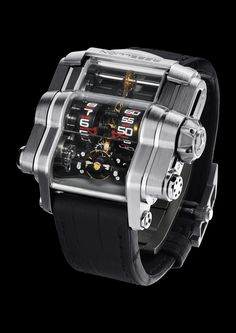 T-1000 with titanium case. The T-1000 features SIX mainspring barrels with a world-record 1,000 hour power reserve, generated by an over-sized winding lever integrated into the back of the case, made from natural and blackened titanium. For more information, please visit: http://www.rebellion-timepieces.com/collection-t-1000-time-machine.php#1