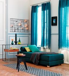 DIY Bleached Curtains. Love the gorgeous turquoise blue color contrasted with the white bottom. Almost looked like they were dipped dyed.