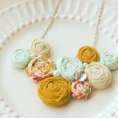 To make for myself. Mint, cream, mustard and floral rosette bib statement necklace.