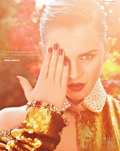"""In the Garden – Actress Emma Watson stars in the """"Pick Me Up"""" issue of i-D Magazine. Donning red lips and slicked back hair, Emma sports girly looks styled by Caroline Sieber and photographed by Mariano Vivanco in the outdoor shoot."""