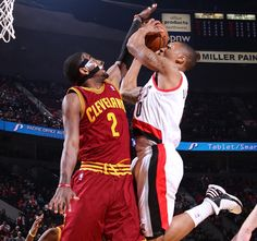 Guard Kyrie Irving defends the basket against Damian Lillard of the Portland Trail Blazers at Rose Garden Arena on January 16, 2013 in Portland, Oregon. - photo courtesy of Sam Forencich / NBAE via Getty Images.