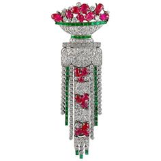 An important Art Deco brooch comprised with an opulence of diamonds, emeralds, and carved rubies combined to form a vase motif, exquisitely crafted in platinum. Made in France dimensions approx. 3 x 1 Bijoux Art Deco, Art Deco Jewelry, Fine Jewelry, Jewelry Ideas, Jewelry Rings, Jewelry Accessories, Diamond Brooch, Art Deco Diamond, Emerald Diamond
