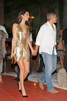 Amal Clooney in a gold lame cocktail dress