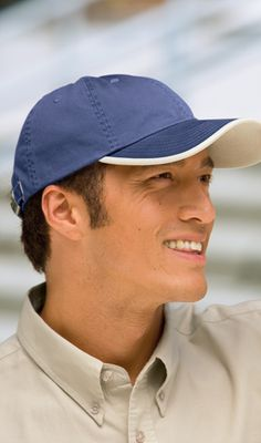 The Port Authority UBWT Twill Cap with Contrast Visor Trim and Underbill  has two-tone 79c3b28c7403