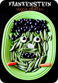 Frankenstein Veggie Platter ~ snap peas, olives, sliced cucumbers and baby carrots