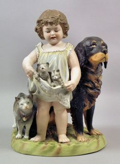 Continental bisque porcelain group  - Young girl with a dog, a cat and kittens,  late 19th Century, 11.5ins high