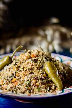Rouz jerbi is a Tunisian dish prepared with rice, which includes various vegetables, meats, spices and herbs, that can change according to the seasons. Tunisia Recipe, Tunisian Food, Spices And Herbs, Middle Eastern Recipes, Couscous, Fried Rice, Indian, Foods, Traditional