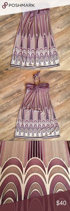 """BCBGMAXAZRIA Art Deco halter dress Soft & stretchy polyester blend for wrinkle free, easy elegance. Wear the halter strap as a bow or tie up behind your neck. The Art Deco pattern is so cool & different. I've always been fond of that style architecture! Colors are light & dark cool toned purple with grey & white. The last photo shows more mauve than it is. 30"""" length, ribcage 30"""" to 40"""". This brand usually runs large but this garment is more true to size. Would accommodate up to a C cup…"""