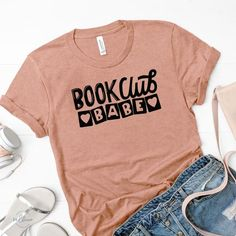 Book Club Babe t-shirt. Exclusive bookish t-shirt designed with all the book club babes out there in mind. Wear this unique t-shirt in Lilac or Sunset to your favorite book club meeting! Bookish gift for bibliophiles. Book Shirts, Club Shirts, Clubbing Outfits Nightclub, Vest Outfits For Women, Summer Club Outfits, Babe T Shirt, Book Lovers Gifts, Teacher Shirts, Meeting Book