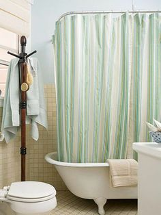 Love the idea of a coat rack in the bathroom
