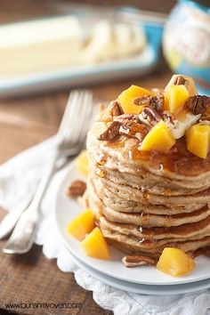 Summery peach pancakes dotted with chopped pecans! The perfect breakfast!