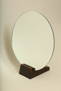 Art Deco Macassar Ebony Table Mirror by Emile-Jacques Ruhlmann ca. 1930. Circular mirror on solid macassar ebony base by Emile Jacques RUHLMANN (1879-1933).  Stamped: Ruhlmann and A in a circle for Atelier A. Literature:  Florence Camard, Ruhlmann: Master of Art Deco, Harry N. Abrams, NY, 1984 , p. 226 (hva)