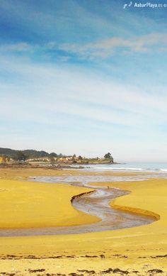 Winding river at the Espasa beach in Asturias, Spain.