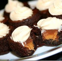 Rolo Brownie Bites with Caramel Cream Cheese Frosting Ingredients: 1 box fudge brownie mix plus necessary eggs, oil & water per package instructions (or your favorite homemade recipe) 24 Rolo candies plus extras for the cook's snack 4 TBS. butter, softened at room temperature 4 oz. cream cheese, softened at room temperature 2 TBS. caramel sauce 1 cup confectioners sugar