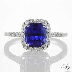 Such a beautiful, classical ring. Vivid, cornflower blue Tanzanite encased in glowing white Diamonds. Timeless and classically elegant.