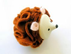 DIY felt made hedge hog SO CUTE! I'd use a real acorn head though, and hmmm what for the nose and eyes... ?