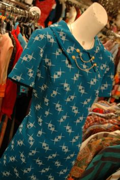 """1960s teal knit dress with """"collar chain"""" detail"""