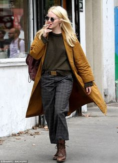 Bad habit: Emma (born Emily) was also seen puffing on a cigarette while strutting down the bustling Big Apple street