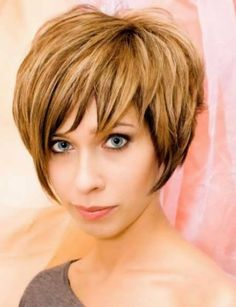 Cute Short Hair Styles for Women 2014 -- if I could ever get that kind of volume out of my hair