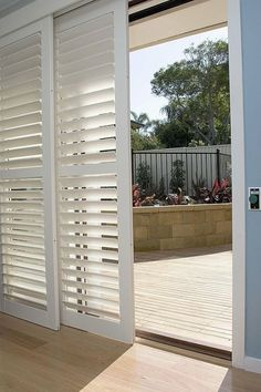 Shutters on sliding patio doors add privacy and soften sunlight........maybe a great idea for my living room window that let's in so much sun and heat in the summer?!!!!