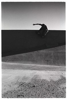 Skateboarding and a geometric shadow.