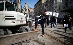Sofia, Bulgaria: A man poses while wearing a pair of women's high heels during the 'walk a mile in her shoes' initiative