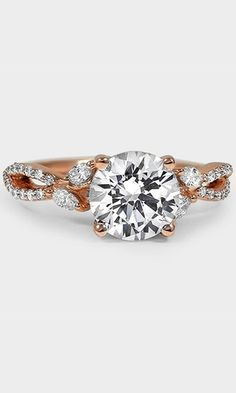 This flawless ring features delicate vines adorned with sparkling round diamonds and four marquise diamond buds that reach for the center diamond.