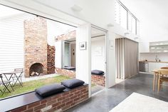 In Melbourne. Rugged: Recycled brick windowseats echo the original chimney that is now the focal point of a courtyard. Photo: Tim Ross.