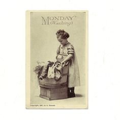 This real photo post card is called Monday Washing. It shows a young girl in a gingham pinafore with a large tub of laundry and a washboard.  At the