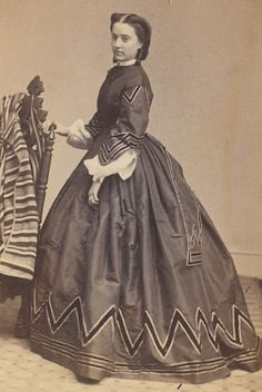1860s-Lady cool contrasting details on hemline and sleeves