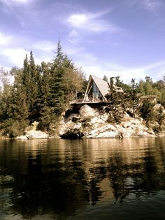 A-Frame Cabin on the lake. Note the slight forward lean in the roof. Passive solar implications?
