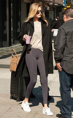 Gigi Hadid at JFK airport, October 2015, wearing an IRO Marvina Camo Long Sleeve Tee http://api.shopstyle.com/action/apiVisitRetailer?id=491448960&pid=uid7729-3100527-84&pid=uid7729-3100527-84, a Marc Jacobs bag and Adidas shoes. #style #celebstyle
