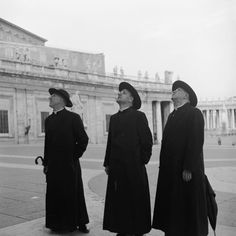 Three priests during a visit to Vatican City. Circa 1955.