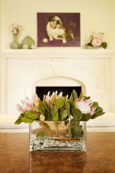 An arrangement of giant protea flowers frame the view of Linsley Lambert's painting, �Pickwick Prince of the Heart�.