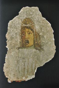 Roman art, Roman theater mask on roman fresco with theatrical mask, 1st century A.D. Roman art, Roman theater mask, 36 cm high. Private collection