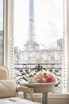 Paris Street Fine Art Photograph Title: Coffee and Flowers in Paris A quiet moment with coffee and flowers on ornate balcony overlooking the Eiffel Tower on a winter afternoon in the 7th arrondissement. – Printed on beautiful, premium quality archival photographic paper with long-lasting inks. –